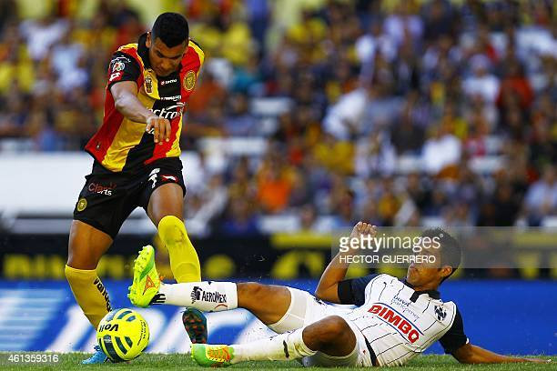 Andres Rios of Leones Negros vies forthe ball with Efrain Velarde of Monterrey during their Mexican Clausura 2015 tournament football match at...
