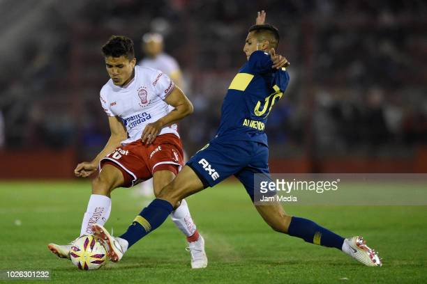 Andres Roa of Huracan and Agustin Almendra of Boca Juniors fight for the ball during a match between Huracan and Boca Juniors as part of Superliga...