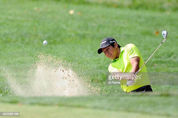 Andres Romero hits a bunker shot on the 13th hole during the second round of the Quicken Loans National at Congressional Country Club on June 27 2014...