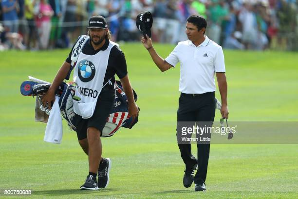 Andres Romero of Argentina acknowledges the crowd on the 18th hole during the final round of the BMW International Open at Golfclub Munchen...