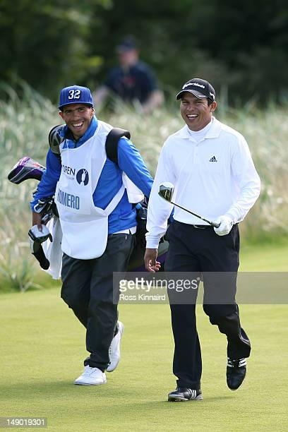 Andres Romero of Argentina and his guest caddie, footballer Carlos Tevez of Manchester City and Argentina during the final round of the 141st Open...