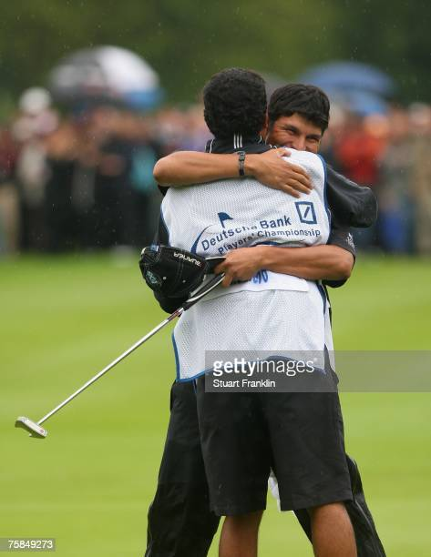 Andres Romero of Argentina celebrates with his caddy after winning The Deutsche Bank Players Championship of Europe at Gut Kaden Golf and Land Club...