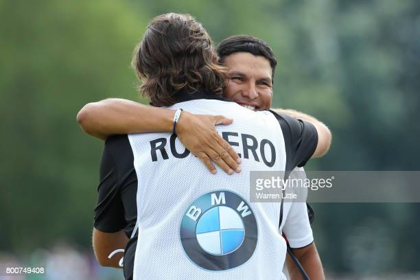 Andres Romero of Argentina embraces his caddie on the 18th green during the final round of the BMW International Open at Golfclub Munchen Eichenried...