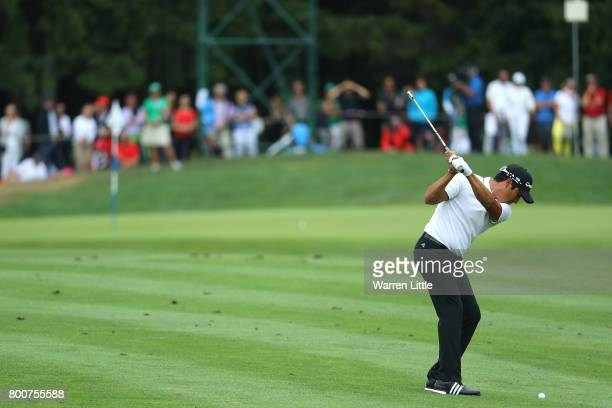 Andres Romero of Argentina hits his second shot on the 16th hole during the final round of the BMW International Open at Golfclub Munchen Eichenried...