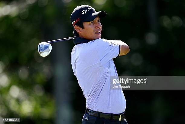 Andres Romero of Argentina plays his shot from the 14th tee during the first round of the Travelers Championship at TPC River Highlands on June 25...