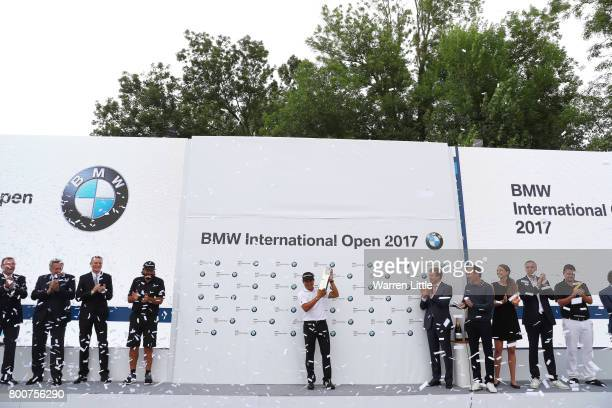 Andres Romero of Argentina poses with the trophy following his victory during the final round of the BMW International Open at Golfclub Munchen...