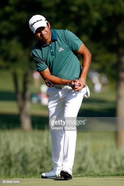 Andres Romero of Argentina putts on the fifth green during thei first round of the World Golf Championships Bridgestone Invitational at Firestone...