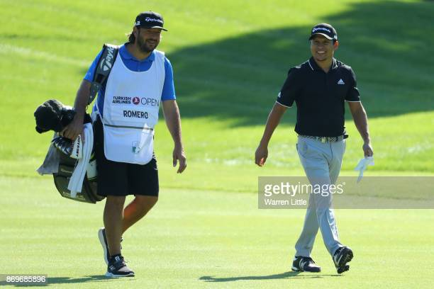 Andres Romero of Argentina walks down the 1st hole during the second round of the Turkish Airlines Open at the Regnum Carya Golf Spa Resort on...