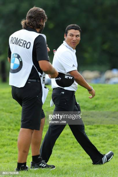 Andres Romero of Argentina walks off the 18th green with his caddie during the final round of the BMW International Open at Golfclub Munchen...