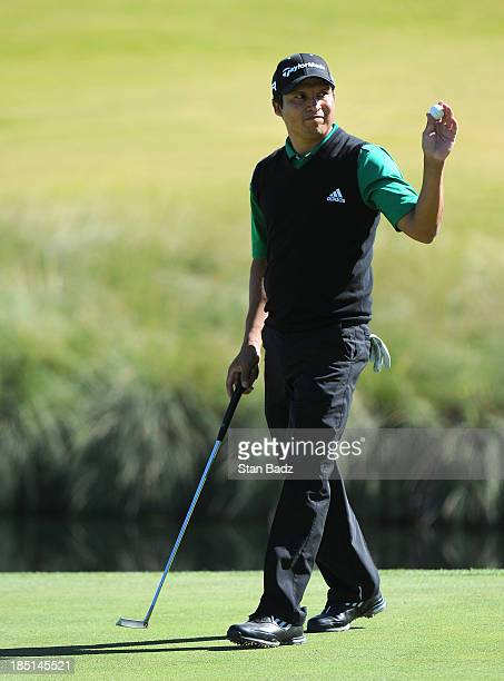 Andres Romero of Argentina waves his golf ball as he exits the 18th green during the first round of the Shriners Hospitals for Children Open at TPC...