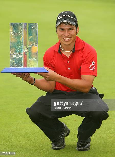 Andres Romero of Argentina with the trophy for winning The Deutsche Bank Players Championship of Europe at Gut Kaden Golf and Land Club on July 29...