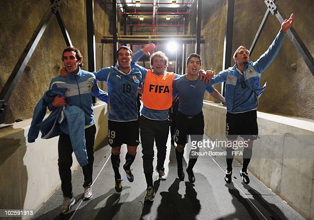 Andres Scotti Diego Lugano Luis Suarez and Sebastian Eguren of Uruguay celebrate winning the penalty shoot out and progress to the semi finals during...