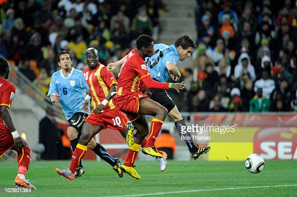 Andres Scotti of Uruguay clears the ball during the 2010 FIFA World Cup South Africa Quarter Final match between Uruguay and Ghana at the Soccer City...