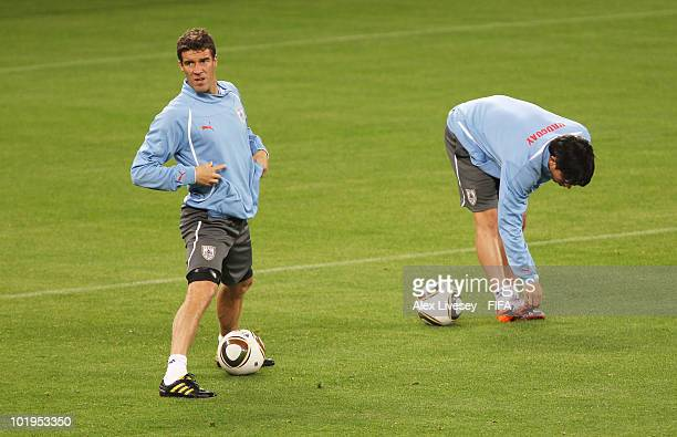 Andres Scotti of Uruguay stretches during the Uruguay training session ahead of the 2010 FIFA World Cup South Africa at Green Point stadium on June...