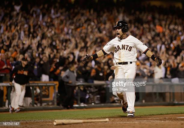 Andres Torres of the San Francisco Giants celebrates as he runs home to score the winning run on a hit by Brandon Belt of the San Francisco Giants in...