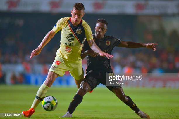 Andres Uribe of America fights for the ball with Jefferson Murillo Aguilar of Veracruz during the 17th round match between Veracruz and America as...