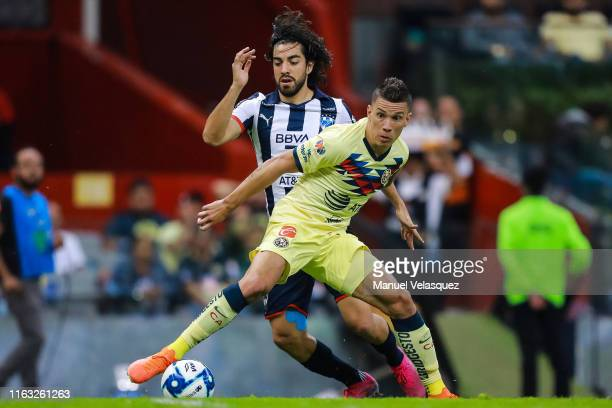 Andres Uribe of America struggles for the ball against Rodolfo Pizarro of Monterrey during the 1st round match between America and Monterrey as part...