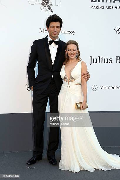 Andres Velencoso and Kylie Minogue arrives at amfAR's 20th Annual Cinema Against AIDS at Hotel du CapEdenRoc on May 23 2013 in Cap d'Antibes France