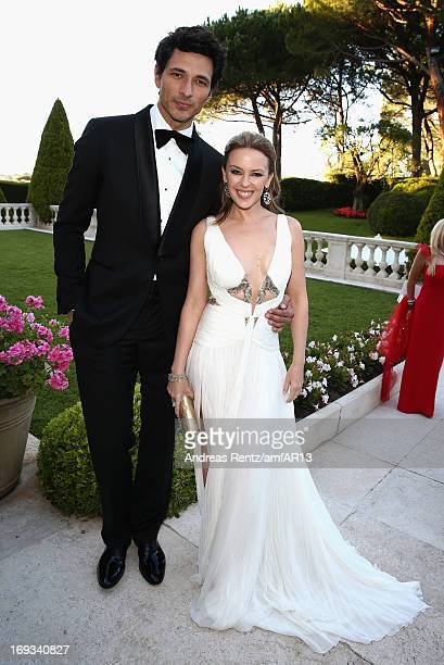 Andres Velencoso and Kylie Minogue attend amfAR's 20th Annual Cinema Against AIDS during The 66th Annual Cannes Film Festival at Hotel du CapEdenRoc...