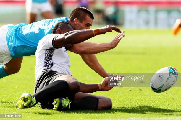Andres Vilaseca of Uruguay and Vereniki Goneva of Fiji compete for the ball during the Rugby World Cup 2019 Group D game between Fiji and Uruguay at...