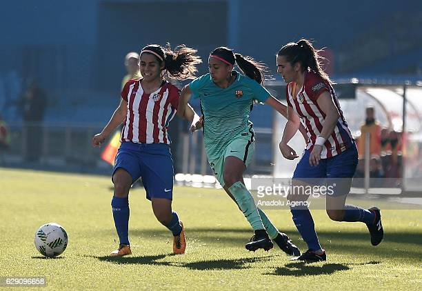 Andressa Alves of Barcelona in action against Kenti Robles and Eshter of Atletico Madrid during the Superliga Women match between Atletico Madrid and...