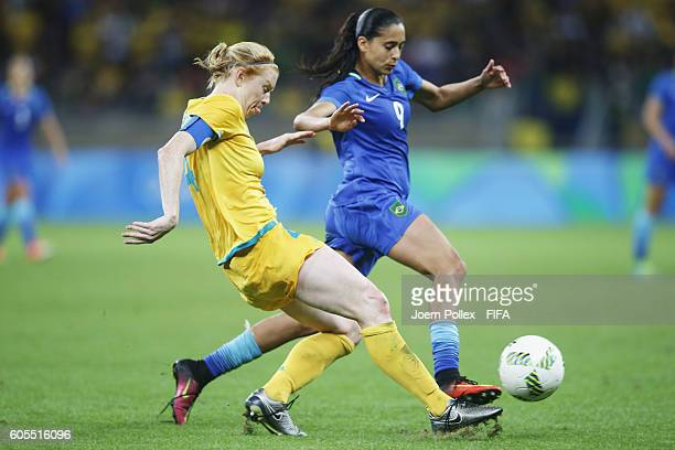 Andressa Alves of Brasil and Clare Polkinghorne of Australia compete for the ball during the Women's Quarter Final match between Brasil and Australia...