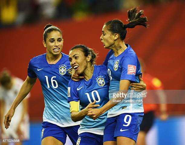 Andressa Alves of Brazil celebates scoring her goal with Martal during the FIFA Women's World Cup 2015 group E match between Brazil and Spain at...