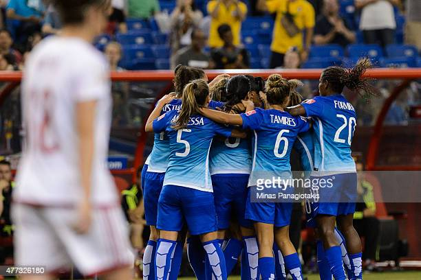 Andressa Alves of Brazil celebrates her goal with teammates during the 2015 FIFA Women's World Cup Group E match against Spain at Olympic Stadium on...
