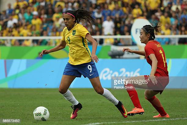 Andressa Alves of Brazil controls the ball against Rong Zhao of China during the Women's Group E first round match between Brazil and China PR during...