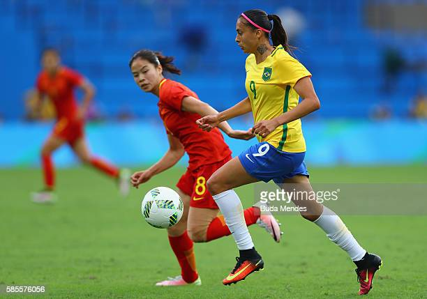 Andressa Alves of Brazil controls the ball against Ruyin Tan of China during the Women's Group E first round match between Brazil and China PR during...