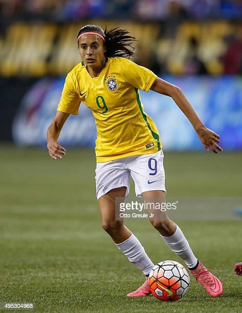 Andressa Alves of Brazil dribbles against the United States at CenturyLink Field on October 21 2015 in Seattle Washington