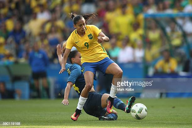 Andressa Alves of Brazil is tackled during the Women's Football Semi Final between Brazil and Sweden on Day 11 of the Rio 2016 Olympic Games at...