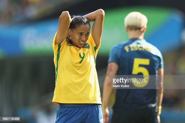 Andressa Alves of Brazil reacts during the Women's Football Semi Final between Brazil and Sweden on Day 11 of the Rio 2016 Olympic Games at Maracana...