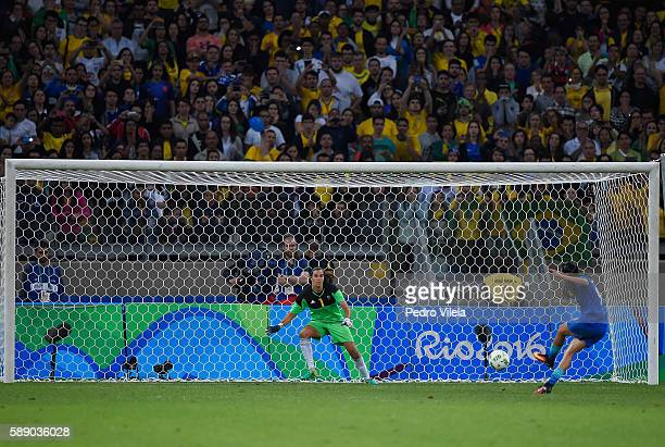 Andressa Alves of Brazil shoot against goalkeeper Lydia Williams of Australia in Penalties Shootout during the Women's Football Quarterfinal match at...