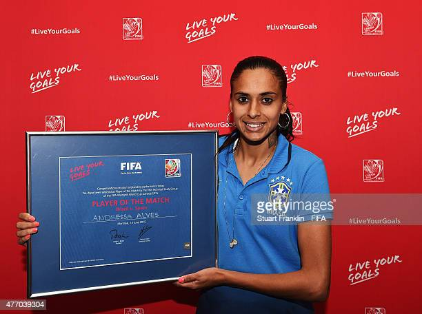 Andressa Alves of Brazil with her player of the match award after the FIFA Women's World Cup 2015 group E match between Brazil and Spain at Olympic...