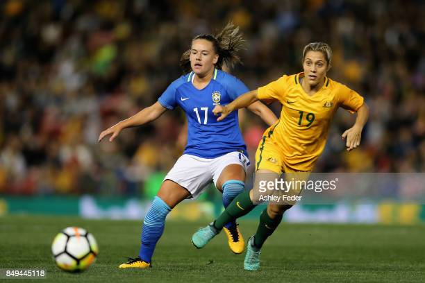 Andressa Cavalari Machry of Brazil is contested by Katrina Gorry of Australia during the Women's International match between the Australian Matildas...