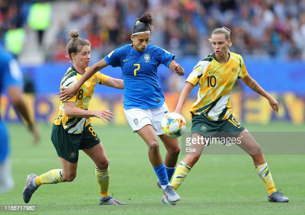 Andressa of Brazil is challenged by Elise KellondKnight of Australia and Emily Van Egmond of Australia during the 2019 FIFA Women's World Cup France...