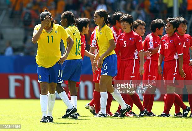 Andressa of Brazil looks dejected after the 2010 FIFA Women's World Cup Group B match between Brazil and North Korea at the Bielefeld Arena on July...