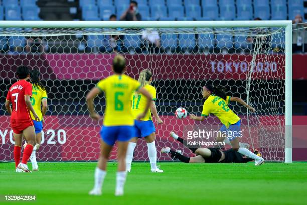 Andressa of Team Brazil celebrates after scoring their side's fifth goal from the penalty spot during the Women's First Round Group F match between...
