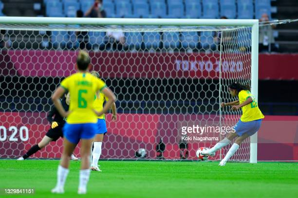 Andressa of Team Brazil scores their side's fourth goal from the penalty spot during the Women's First Round Group F match between China and Brazil...