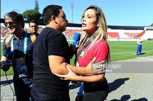 Andressa Urach a former Miss Bumbum pageant contestant is escorted by members of security out of the grounds during a Portugal team training session...