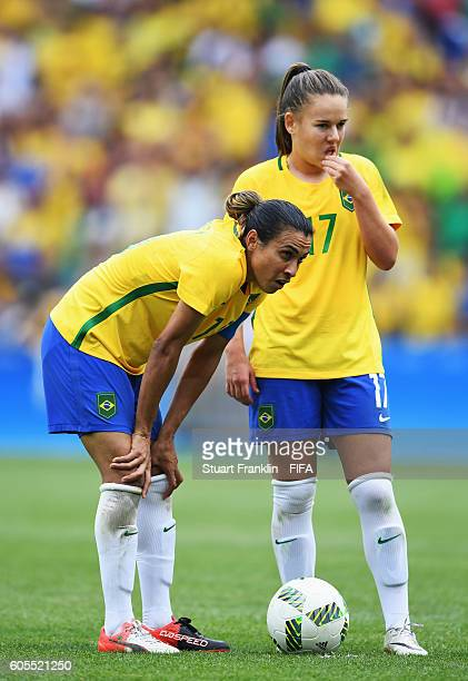 Andressinha and Marta of Brazil look dejected during the Olympic Womens Semi Final Football match between Brazil and Sweden at Maracana Stadium on...