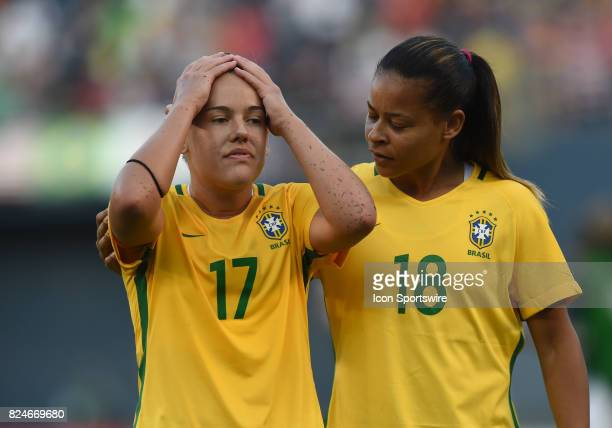 Andressinha of Brazil and Fran of Brazil walk off the field in dejection during the Tournament of Nations soccer match between USA and Brazil on July...