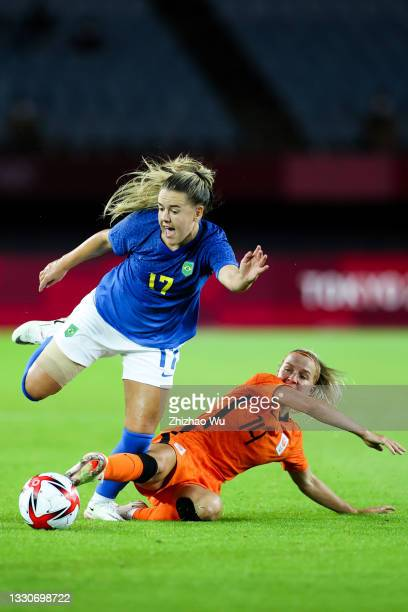Andressinha of Brazil competes for the ball with Groenen Jackie of Netherland during the Women's First Round Group F match on day one of the Tokyo...
