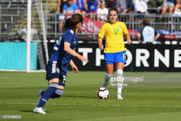 Andressinha of Brazil controls the ball against the defense of Risa Shimizu of Japan during the first half of a Tournament of Nations game played at...