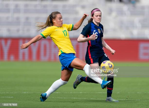 Andressinha of Brazil defends Rose Lavelle of the USWNT during a game between Brazil and USWNT at Exploria Stadium on February 21, 2021 in Orlando,...