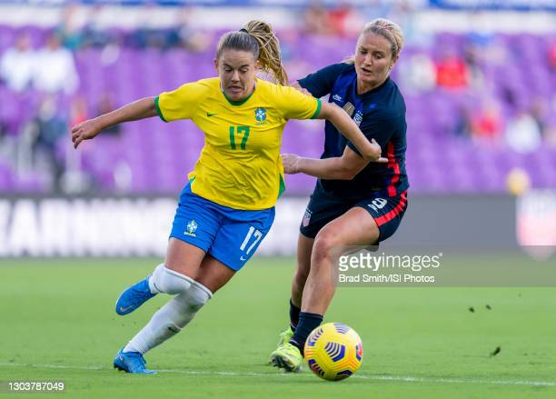 Andressinha of Brazil fights for the ball with Lindsey Horan of the USWNT during a game between Brazil and USWNT at Exploria Stadium on February 21,...