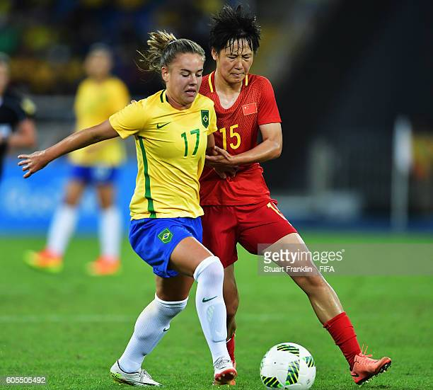 Andressinha of Brazil is challenged by Zhang Rui of China during the Olympic Women's Football match between Brazil and China PR during at Olympic...