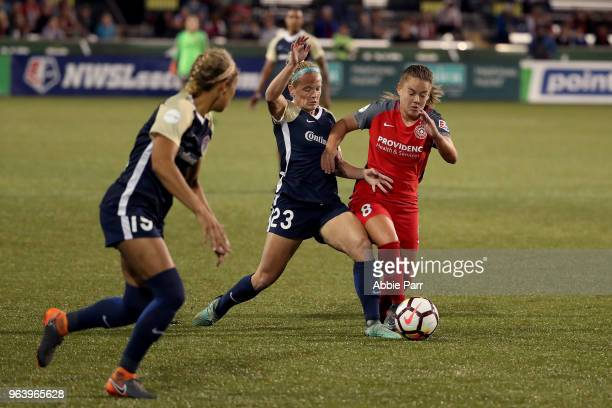 Andressinha of Portland Thorns FC fights for the ball against Kristen Hamilton of North Carolina Courage in the second half during their game at...