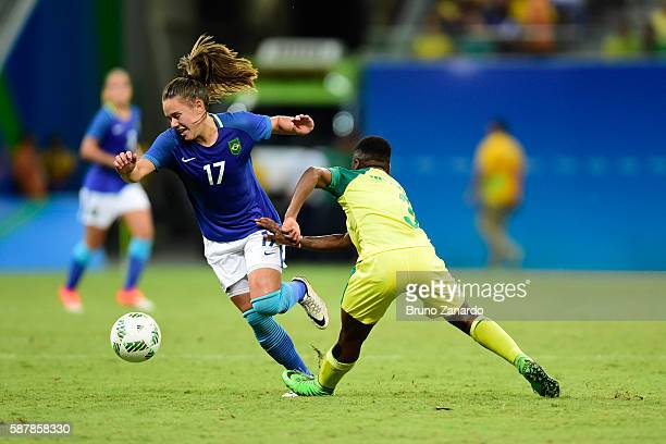 Andressinha player of Brazil goes to ground after a challenge by Nothando Vilakazi player of South Africa during 2016 Summer Olympics match between...